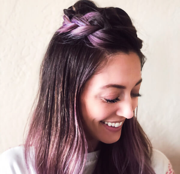 Hairstylist Jill Buck smiling with purple hair