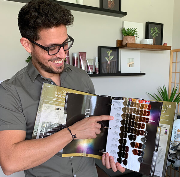 Stylist Ricardo Santiago showing hair color swatches