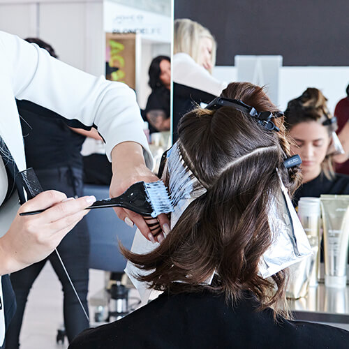 Women getting hair colored in salon