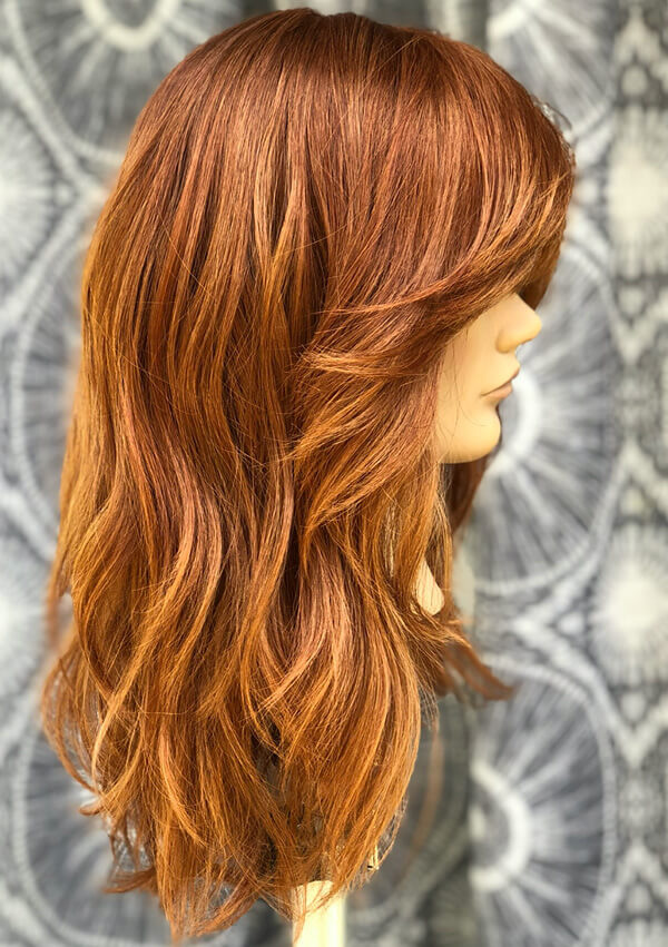 Mannequin head with wavy red hair