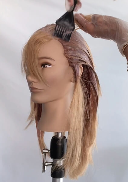 Mannequin head being colored professionally