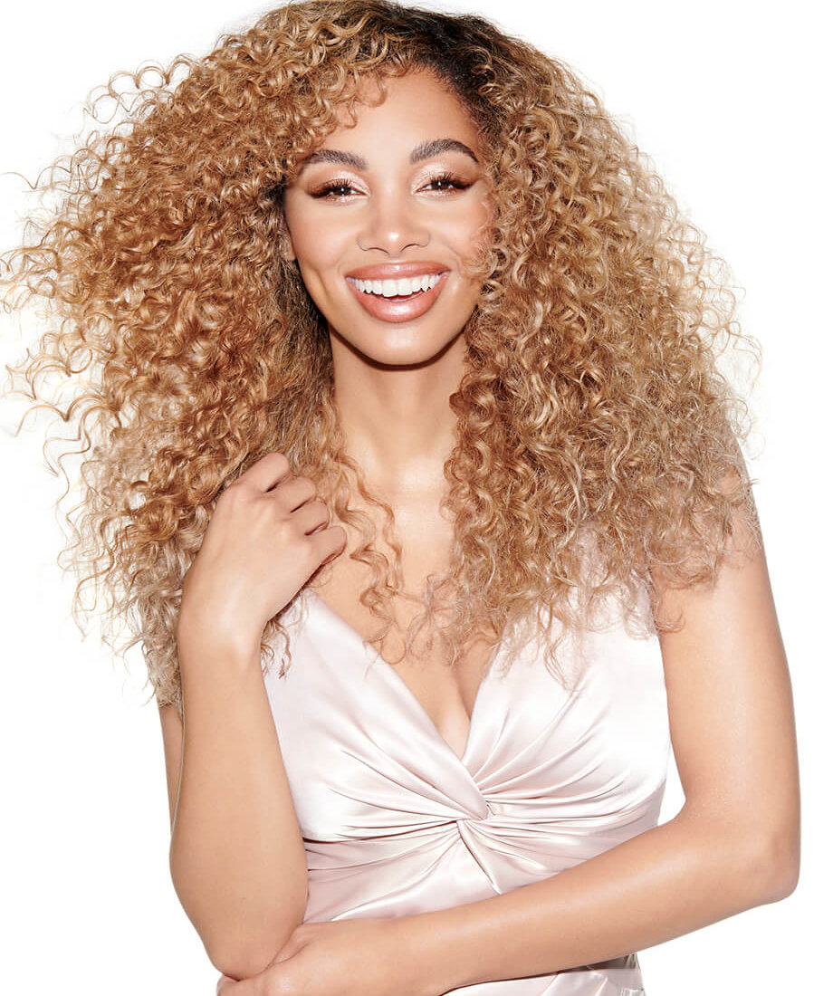 Woman with highlighted curly hair