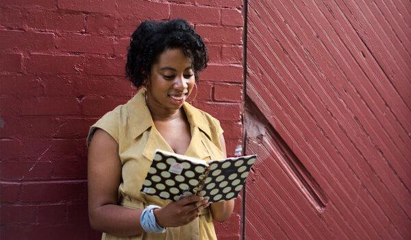Women reading book outside