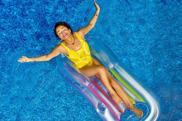 Women in pool on float