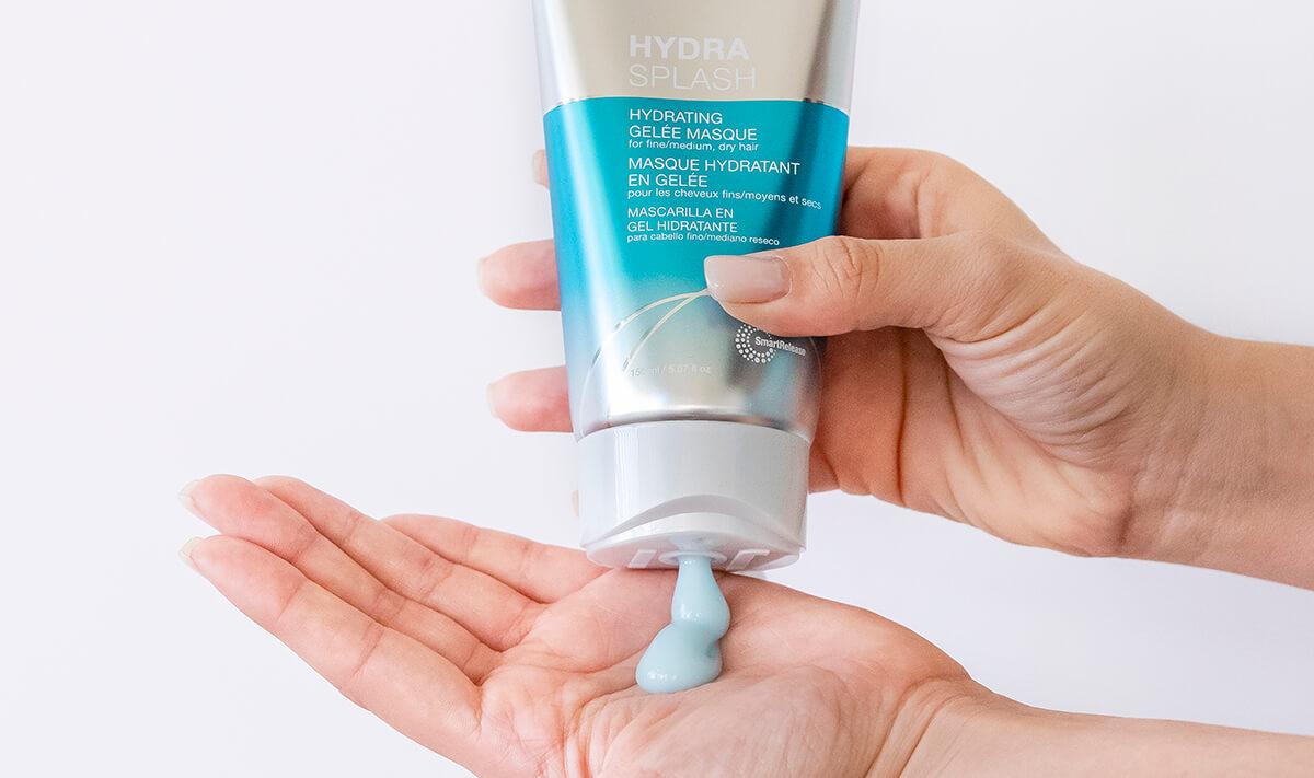 Joico HydraSplash Gelee Masque bottle squeezing into hand
