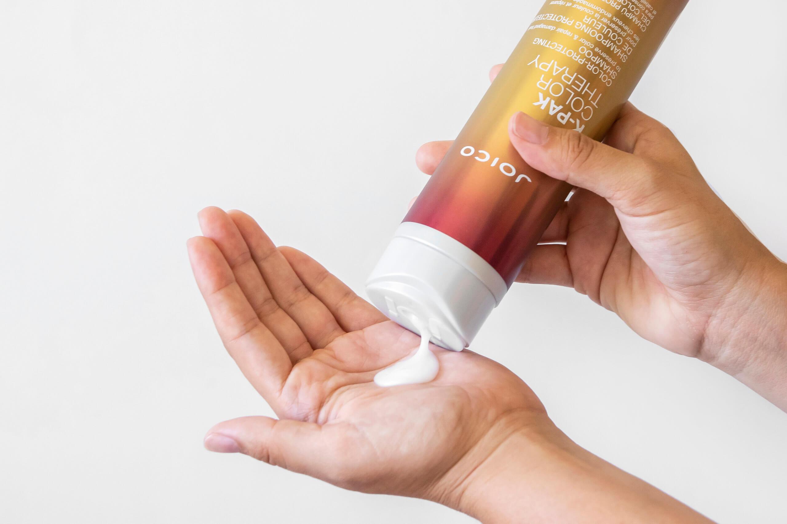 Joico K-Pak shampoo squeezing into hand