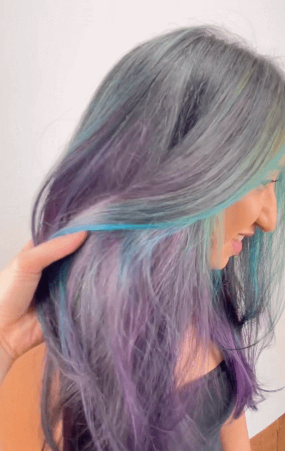 woman showing off grey, purple and blue hair
